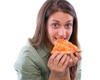 Adolescente que come la pizza Fotografía de archivo libre de regalías