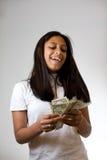 Adolescente que conta o dinheiro Imagem de Stock Royalty Free