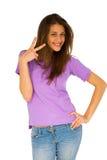 Adolescente que da la muestra de paz Fotos de archivo