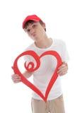 Adolescente que detiene a la tarjeta del día de San Valentín roja del beso del corazón del amor Fotografía de archivo libre de regalías