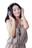 Adolescente que disfruta de música Fotografía de archivo libre de regalías