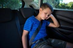 Adolescente que duerme en el coche Fotografía de archivo libre de regalías