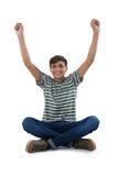 Adolescente que ejercita contra el fondo blanco Foto de archivo