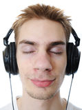 Adolescente que escucha la música Imagen de archivo