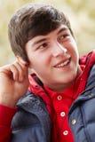 Adolescente que escucha la música Fotografía de archivo