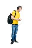 Adolescente que escucha la música aislada en blanco Imagenes de archivo