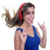 Adolescente que escucha la música en los auriculares inalámbricos aislados Fotografía de archivo