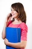 Adolescente que habla en el teléfono. Fotografía de archivo