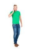 Adolescente que habla en el teléfono en blanco Fotos de archivo libres de regalías