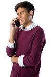 Adolescente que habla en el teléfono móvil Foto de archivo libre de regalías