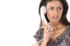 Adolescente que habla sobre el teléfono Fotos de archivo