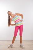 Adolescente que hace estirando ejercicios Imagen de archivo libre de regalías