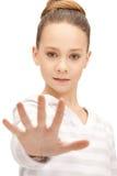 Adolescente que hace gesto de la parada Fotografía de archivo