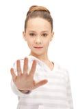 Adolescente que hace gesto de la parada Imagenes de archivo