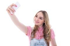 Adolescente que hace la foto del selfie en el teléfono elegante aislado en pizca Imagen de archivo libre de regalías
