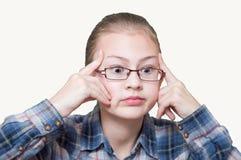 Adolescente que intenta recordar Foto de archivo libre de regalías