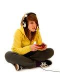 Adolescente que juega al juego video Imagenes de archivo