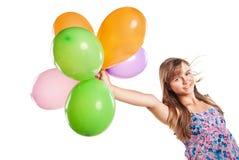 Adolescente que juega con los globos Fotografía de archivo