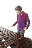 Adolescente que juega el marimba en estudio Fotos de archivo