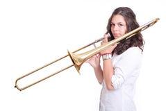 Adolescente que juega el trombón Fotos de archivo