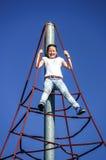 Adolescente que juega en patio del niño Imágenes de archivo libres de regalías