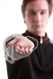 Adolescente que lleva a cabo hacia fuera la mano Fotografía de archivo libre de regalías