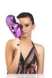 Adolescente que lleva a cabo la máscara Imagen de archivo libre de regalías