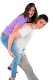 Adolescente que lleva a cuestas al adolescente Imagen de archivo libre de regalías