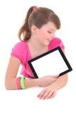 Adolescente que miente con la PC de la tablilla aislada sobre blanco Imagen de archivo libre de regalías