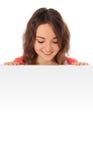 Adolescente que mira abajo de muestra en blanco Imagen de archivo libre de regalías