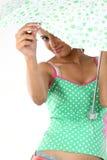 Adolescente que mira del paraguas Foto de archivo