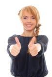 Adolescente que muestra la muestra de dos manos buena Imagenes de archivo
