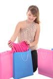 Adolescente que muestra la nueva alineada después de hacer compras Foto de archivo libre de regalías