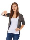 Adolescente que muestra los pulgares abajo Imagen de archivo