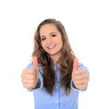 Adolescente que muestra los pulgares para arriba Fotografía de archivo libre de regalías