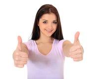 Adolescente que muestra los pulgares para arriba Fotos de archivo