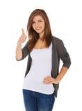 Adolescente que muestra los pulgares para arriba Foto de archivo libre de regalías