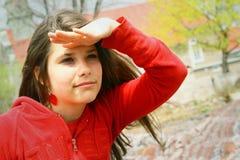 Adolescente que parece lejano Fotografía de archivo libre de regalías