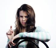 Adolescente que parece preocupado aislado en blanco Imagenes de archivo