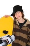 Adolescente que prende um snowboard foto de stock