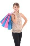 Adolescente que presenta con los bolsos de compras Imágenes de archivo libres de regalías