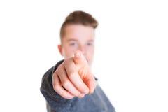 Adolescente que señala adentro a la cámara Imagen de archivo libre de regalías