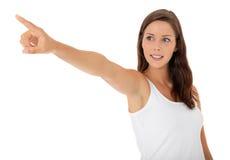 Adolescente que señala con el dedo Fotografía de archivo