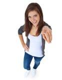 Adolescente que señala con el dedo Foto de archivo