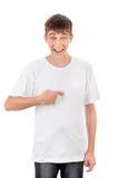Adolescente que señala en sí mismo Foto de archivo