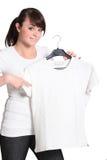 Adolescente que señala a la camisa Imagen de archivo