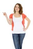 Adolescente que señala a la cara Imagen de archivo