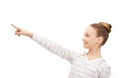 Adolescente que señala su finger Foto de archivo