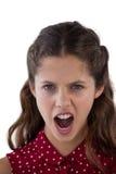 Adolescente que se opone al fondo blanco Imagen de archivo