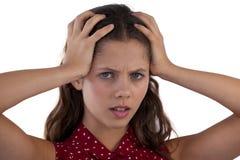 Adolescente que se opone al fondo blanco Fotos de archivo